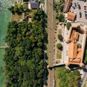Drohnenaufnahme vom Schloss Grandson mit Bahnlinie und Neuenburgersee